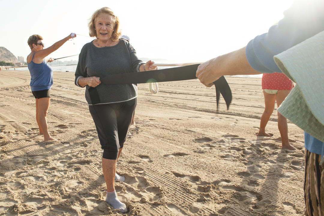 elderly women on beach exercising Alicante